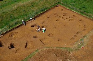 Archaeologists excavate an Iron Age roundhouse at Burrough Hill hillfort. Image credit: Aerial-Cam
